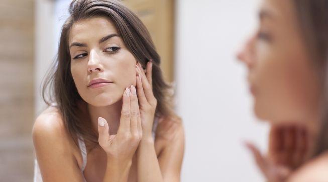 woman-looking-face-mirror.jpg.653x0_q80_crop-smart
